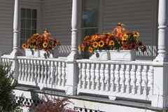 Autumn Flowers on Railing. Autumn Flowers on a Porch Railing royalty free stock photography
