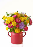 Autumn flowers. Still life with colorful autumn flowers in red vase isolated Royalty Free Stock Photo