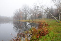 Autumn Fog. Autumn landscape in New England with fog on the water Royalty Free Stock Image