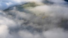 Autumn fog floats over the landscape among the trees. Czech Republic stock footage