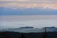 Autumn fog lingering above Lake Geneva. French Alps behind, Nyon, Switzerland Stock Images
