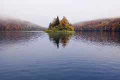 Autumn Fog on Plitvice Lakes. Misty morning on Plitvice lakes with colorful autumn leaves Royalty Free Stock Images