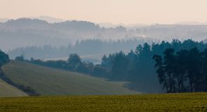 Autumn foggy and misty sunrise landscape stock image