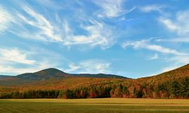 Autumn Foiliage under whispy clouds at Grafton Notch, Maine, USA Royalty Free Stock Image