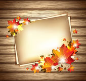 Autumn Foliage with Paper Sheets on Wooden Background Stock Photography