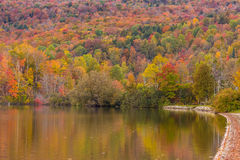 Autumn foliage and reflection in Vermont, Elmore state park Stock Image