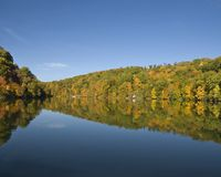 Autumn foliage reflections on a lake. Reflections of fall foliage in cheat lake, Morgantown, WV Stock Images