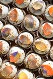 Autumn Fondant Leaves Cake Pops. Cakepops with fondant leaves in brilliant autumn colors royalty free stock photos