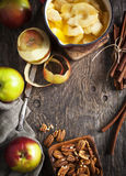 Autumn food background with apples, spices and nuts. Ingredients Royalty Free Stock Images
