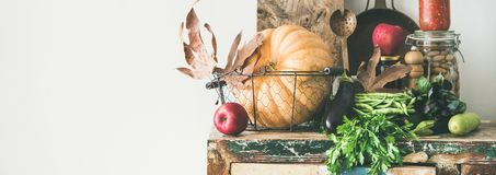 Free Autumn Food Ingredients And Utensils Over Wooden Cupboard, Wide Composition Royalty Free Stock Image - 127202876