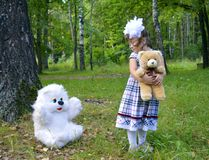 Autumn forest bear toy smiling people park toy  toy outdoors childhood love portrait fun green summer smile woman pet child animal Royalty Free Stock Photography