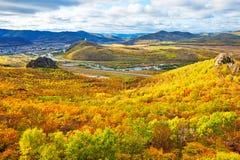 Autumn forest hills megalith cloudscape Stock Photos