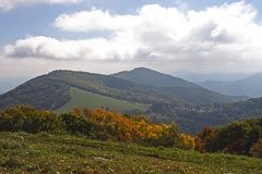 Autumn forest and mountains. Scenic view of autumn forest with mountains and cloudscape in background; North Carolina, U.S.A Royalty Free Stock Photos