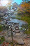 Autumn forest in the mountains and stairs in rock Royalty Free Stock Photos