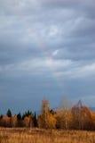 Autumn forest and a rainbow Stock Photo