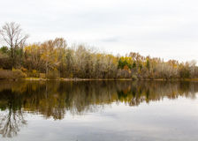 Autumn forest reflected in the water landscape Stock Photo