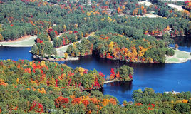 Autumn forest and river. Aerial view of colorful Autumnal forest and blue river, Georgia, U.S.A Stock Photos