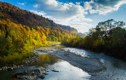 Autumn forest and sky and mountains and river. Autumn forest and blue sky and mountains and river Stock Photo