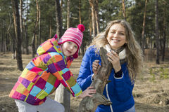 In autumn forest walk mother and daughter. Stock Photos