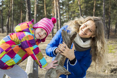 In autumn forest walk mother and daughter. Stock Image