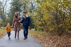 Autumn forest walk with the son family. 1 Royalty Free Stock Image