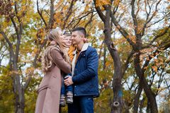 Autumn forest walk with the son family. 1 Royalty Free Stock Photography