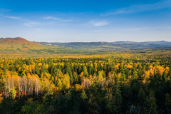 Autumn in the forests from the height. The beginning of autumn from the height of the mountains. Taganay. The Ural ridge stock images
