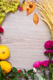 Autumn frame with pumpkins, wheat and leaves Stock Photo