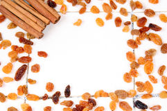 Autumn frame of raisins and cinnamon with copy space Stock Photography