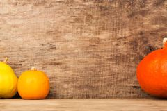 Autumn frame on wooden background with pumpkins Stock Photography