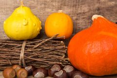 Autumn frame on wooden background with pumpkins Stock Photos