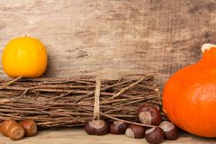 Autumn frame on wooden background with pumpkins Royalty Free Stock Photo