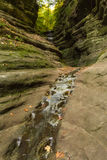 Autumn in French Canyon,. Early fall/autumn morning in French Canyon with water lightly flowing through the canyon.  Starved Rock State Park, Illinois Royalty Free Stock Photos
