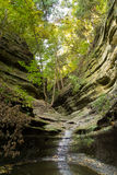 Autumn in French Canyon,. Early fall/autumn morning in French Canyon with water lightly flowing through the canyon.  Starved Rock State Park, Illinois Royalty Free Stock Images
