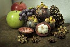 Autumn fresh fruit on wood still life Royalty Free Stock Image