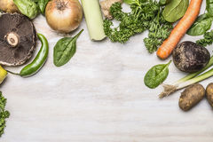 Autumn fresh fruits vegetables and herbs on a white rustic background top view Stock Photo