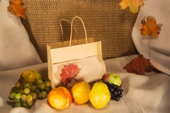 Autumn fruit and a bag with a place for inscription Royalty Free Stock Photos