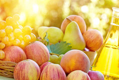 Autumn fruit and wine. On table royalty free stock image