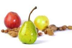 Autumn Fruits. Apples, pear, almonds, hazelnuts and walnuts Royalty Free Stock Photos