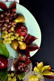 Autumn fruits, apple, grapes and pear. 