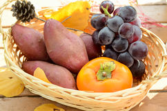 Autumn fruits in basket Royalty Free Stock Photography