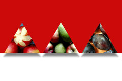 Autumn fruits inside three abstract triangles Royalty Free Stock Photos
