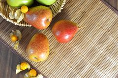 Pears on a straw napkin top view stock photography