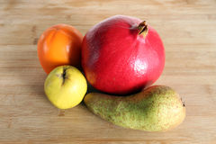 Autumn fruits: pomegranate, persimmon, quince, pear Stock Photography