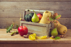 Autumn fruits and pumpkin on wooden table. Thanksgiving dinner royalty free stock image