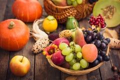 Autumn fruits. On the table stock photos