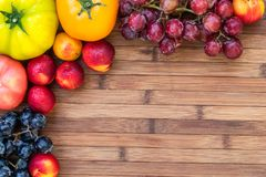 Autumn fruits and vegetables a wood table stock photography