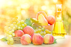 Autumn fruits and white wine Royalty Free Stock Photos