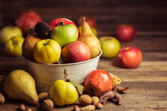 Autumn fruits. On the wooden table Royalty Free Stock Photography
