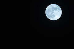 Autumn Full Moon Against a Clear Black Night Sky Royalty Free Stock Photography